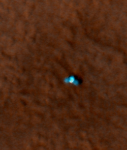 This shows a color image from Mars Reconnaissance Orbiter's High Resolution Imaging Science Experiment (HiRISE) camera. It shows the Phoenix lander with its solar panels deployed on the Mars surface. The Phoenix Mission is led by the University of Arizona, Tucson, on behalf of NASA. Project management of the mission is by NASA's Jet Propulsion Laboratory, Pasadena, Calif. Spacecraft development is by Lockheed Martin Space Systems, Denver. (Image by: NASA/JPL-Caltech/University of Arizona)