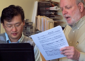 Charles R. Roe, artistic director of the UA's Arizona Opera Theater, and graduate student Eun Pa Lee.
