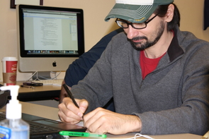 Student veteran Stephen W. Cadette, who served in the Air Force for four years, works on homework at the UA's Student VETS Center.