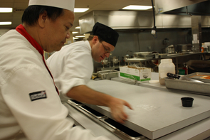 From a Disney dishwasher to UA's executive chef, Kevin Lau (left) has had extensive training and tremendous experiences in between. Lau's aim at the UA is to help improve quality, consistency and the diversity of dining offerings. (Photo credit: Beatriz Verdugo/UANews)