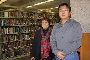 UA librarians Atifa R. Rawan and Yan Han have worked closely on the preservation project, at times traveling to Afghanistan to work directly with their collaborators. (Photo credit: Beatriz Verdugo/UANews)