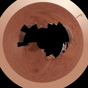 This view combines more than 400 images taken during the first several weeks after NASA's Phoenix Mars Lander arrived on an arctic plain at 62.22 degrees north latitude, 234.25 degrees east longitude on Mars. The full-circle panorama in approximately true color shows the polygonal patterning of ground at the landing area, similar to patterns in permafrost areas on Earth. South is toward the top. Trenches where Phoenix's robotic arm has been exposing subsurface material are visible in the lower half of the image. The spacecraft's meteorology mast, topped by the telltale wind gauge, extends into the sky portion of the panorama. This view comprises more than 100 different camera pointings, with images taken through three different filters at each pointing. It is presented here as a polar projection.