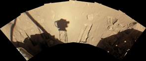 (Click to enlarge) The lander's Surface Stereo Imager camera recorded its view of the workspace on Sol 90, early afternoon local Mars time (overnight Aug. 25 to Aug. 26, 2008). The shadow of the camera itself, atop its mast, is just left of the center of the image and roughly a third of a meter (one foot) wide.