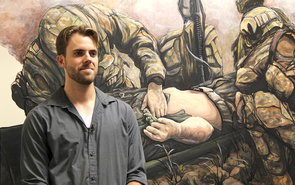 Trevor Anderson, a former student veteran, is the artist behind the murals at the new center. (Photo credit: Beatriz Verdugo/UANews)