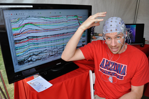 University of Arizona psychology graduate student Ezra Smith shows how a new device and software he's created will help diagnose athletes' injuries to the brain just minutes after they've happened. Smith received a grant from the NCAA to complete the work. Photo: Patrick McArdle/UANews