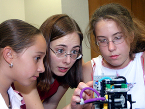 Biomedical Engineering Ph.D. student Lise Johnson (center) was one of the graduate students who taught girl scouts about robotics during the Girl Scout Robotics Camp sponsored by the Electrical and Computer Engineering (ECE) Department.