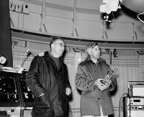 Gerard Kuiper and Ewen Whitaker, holding a 5-inch-by-7-inch lunar camera, are pictured preparing to take photographs of the moon in the dome of the 61-inch Catalina Reflecting Telescope – now called the Kuiper 61-inch Telescope – on Mt. Bigelow in March 1966. (Courtesy of Lunar and Planetary Laboratory)