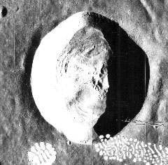 The moon's crater Dawes, about 10 miles in diameter, is left of center and just north of the equator on the face of the moon (NASA photo)