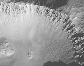Scientists have interpreted gullies around a martian crater seen in this Mars Orbital Camera image as evidence of recent running water. (NASA/Malin Space Systems photo)