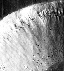 Alcoves and channels on the moon's crater Dawes (NASA photo)