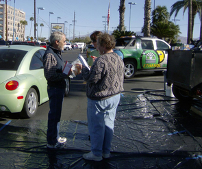 A Tucson resident drops off leftover cooking oil at a collection station during the 2010 Day-After-Thanksgiving Grease Drive. (Photo: Mike Kazz)