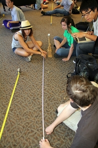 Students do a catapult-building exercise, which is part of the ENGR 102 HS experience.