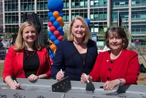 (From left) Phoenix City Councilwoman Kate Gallego, UA President Ann Weaver Hart and President and CEO of Dignity Health in Arizona Linda Hunt participated in the Topping Off ceremony on Tuesday.