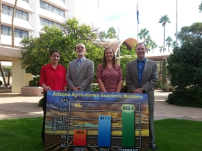 The Economic Impact Analysis Team, from left: Dari Duval, George Frisvold and Ashley Kerna, with College of Agriculture and Life Sciences Dean Shane Burgess (Photo: Faith Schwartz/UA Cooperative Extension)