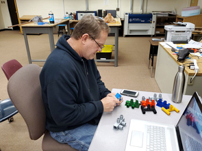 Blue Ridge High School teacher Kevin Woolridge works in the Fab Lab. (Photo by Chris Paxman)