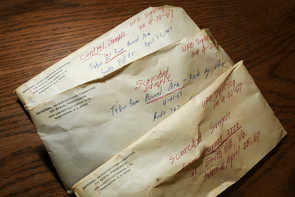 Soil samples, dated 1967, that were collected by James McDonald, a former UA professor and atmospheric scientist, from locations where UFOs reportedly landed, are kept in envelopes. (Photo credit: Norma Jean Gargasz/UANews)