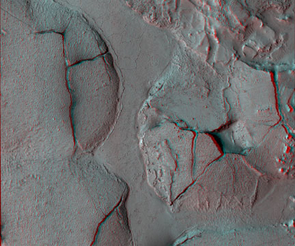 Lava apparently uplifted and formed fractured domes in this anaglyph image taken at Elysium Planitia, Mars, by the HiRISE camera on NASA's Mars Reconnaissance Orbiter. The image becomes three-dimensional when viewed with red-cyan filter glasses.