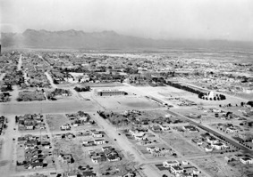 The UA's main campus, facing west, contained a small scattering of buildings in the 1920s compared with today. The polo field is toward the far left of the image. (Photo courtesy of the UA Special Collections)