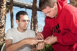 UA engineering students Jon Kidd, left, and Parker Imperl build airplanes as part of the this year's Engineering Week. (Photo by Patrick McArdle/UANews)