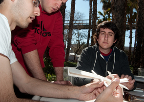 Chris Wellons helps fellow UA engineering students build airplanes. (Photo by Patrick McArdle/UANews)