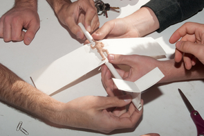 Engineering students had one hour to build their airplanes using paper and paper clips. (Photo by Patrick McArdle/UANews)