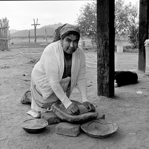 Helga Teiwes took this 1985 photo of Anita Victor grinding wheat on a metate in Meneger's Dam, also known as Ali Chuk, on the Tohono O'odham Nation. (Photo courtesy of Arizona State Museum)