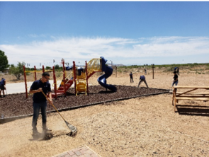 FRONTERA students, in collaboration with SEAHEC, helped to clean up the recreational areas in the Community Center at Winchester Heights, AZ. They also distributed flyers door to door about the next health fair coming to the community. (Photo: Alejandra Zapien/Health Sciences)