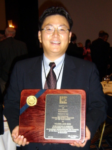 Young-Jun Son with the IIE Outstanding Young Industrial Engineer Award following the award presentation in Atlanta, Ga.