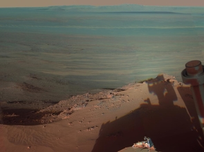 NASA's Mars Rover Opportunity catches its own late-afternoon shadow in this dramatically lit view eastward across Endeavour Crater on Mars. (Image credit: NASA/JPL-Caltech/Cornell/Arizona State University)
