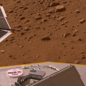 (Click to enlarge) This image, released on Memorial Day, May 26, 2008, shows the American flag and a mini-DVD on the Phoenix's deck, which is about 3 ft. above the Martian surface. The mini-DVD from the Planetary Society contains a message to future Martian explorers, science fiction stories and art inspired by the Red Planet, and the names of more than a quarter million earthlings. (Image by: NASA/JPL-Caltech/University of Arizona)