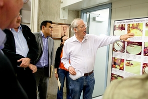 Regents' Professor of Astronomy and Optical Sciences Roger Angel leads the delegation from Mexico on a tour of the UA's Steward Observatory Mirror Lab. (Photo: Hannah Bergeron/UANews)