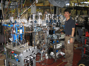 UA researcher Hiroshi Imanaka stands next to the experiment he and UA's Mark Smith have set up inside the Advanced Light Source facility at Lawrence Berkeley National Laboratory in Berkeley, Calif. (Credit: Doug Archer, University of Arizona; Click to enlarge)