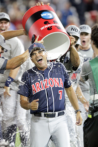 Head coach Andy Lopez gets a championship Powerade shower. (Photo by Adam Streur/Arizona Athletics)