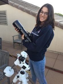 Adriana Mitchell holds one of the CATE telescopes during a practice run. During the total eclipse, 68 identical instruments will work in sync to photograph the sun's corona over an unprecedented time. (Photo courtesy of Padma Yanamandra-Fisher)