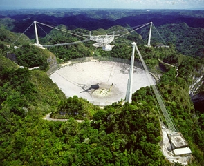 """Featured in movies such as """"Golden Eye"""" and """"Contact,"""" the distinctive dish of Arecibo Observatory is the world's largest single-aperture radio telescope. For this study, it was used to measure the distance between Earth and asteroid 1999 RQ36 to an accuracy of 300 meters (984 feet).  (Photo courtesy of the NAIC - Arecibo Observatory, a facility of the NSF)"""