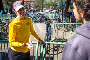 Bike Ambassador Colleen Giles is part of the yellow-shirted crew outside the Nugent Building on the UA Mall. (Photo: Ernesto Trejo/UANews)