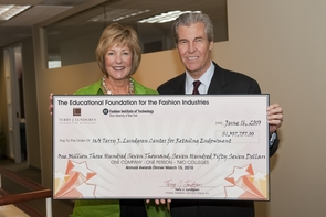 UA alumnus Terry Lundgren presents Melinda Burke, director of the Terry J. Lundgren Center for Retailing, with $1.3 million in proceeds from the New York event.