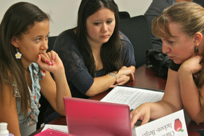 Charissa Jackson and Stephanie Levy talk to UA faculty member Heidi Legg Burross (right) about an assignment in the Teach Arizona educational psychology course. As part of the course, students learn about ways to assess student learning, relying upon both established measurements while also developing their own.