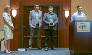Chris Ortiz y Pino, who recently graduated from the UA with a master's degree in planning, accepts the 2017 Best Student Planning Project Award from the Arizona Chapter of the American Planning Association while UA faculty members Kelly Cederberg, Arlie Adkins and Eduardo Guerrero look on.