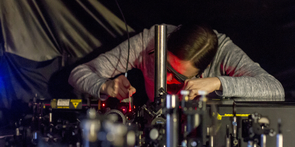 Calley Eads, a fifth-year doctoral student in the UA's Department of Chemistry and Biochemistry, aligns a laser system used to track electrons on time-scales at the limits of what can be measured. In her research, she investigates materials that could one day bring faster computing and more efficient solar cells. (Photo: Kyle Mittan/UANews)