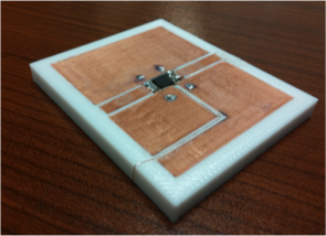In one line of research, Hao Xin's team is developing 3-D printing solutions to the challenges of combining different materials, as in this coplanar waveguide, a device that is used to transmit microwave-frequency signals. (Image: Hao Xin)
