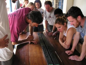 UA geosciences professor Andrew S. Cohen (in the pink shirt) and students in the UA's Nyanza Project look at a sediment core from the bottom of Lake Tanganyika, the world's second deepest lake. (Photo credit: Laura Wetter)