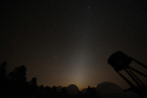 Sometimes mistaken for light pollution, zodiacal light is sunlight that is reflected by zodiacal dust. It is most visible several hours after sunset on dark, cloudless nights surrounding the spring and fall equinoxes, when the Earth's equator is aligned with the plane of the solar system. (Image: Malcol)