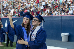 Amanda Ochs, an architecture graduate from Cave Creek, Arizona, and Stefano Saltalamacchia, a cultural understanding major from Ontario, California, pose for a selfie at Commencement. (Photo: John de Dios/UANews)