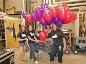 Members of Student Promoters helped set decorations for Bonnie Raitt's September 2012 performance at the UA's Centennial Hall. They are (left to right) Sarah Laus, Lauren Crane, Katie Delahoyde, Jody Liller and Cynthia Haley. (Photo credit: Darsen Campbell)