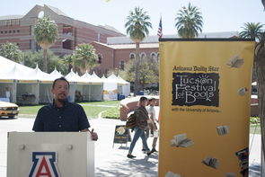 Tucson Mayor Jonathan Rothschild kicked off the Festival of Books by naming TC Tolbert (pictured) as Tucson poet laureate. Rothschild also announced a new book program launched in a partnership between the Arizona Daily Star and the city's Parks and Recreation Department. (Photo: Sarah Ann Gzemski/UA Poetry Center)