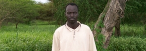 UA master's degree student Abraham Deng Ater returned to his native Sudan last year to reunite with his family. Two months after returning to Tucson, he and two friends established a foundation to help with the relief effort. (Credit: Donald Ray Dains)