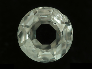Diamonds are carbon minerals. This polished diamond is less than 3.5 millimeters across. (Photo courtesy of the RRUFF Project, UA Department of Geosciences)