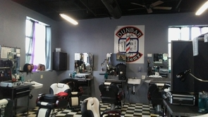 The Dunbar Barber Academy, run by Tio Harris, teaches students how to cut hair and also about business skills.