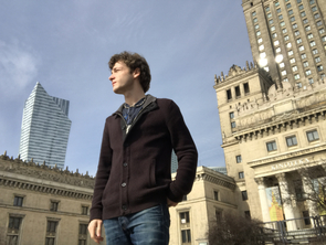 Dylan Hutchison visits the Palace of Culture and Science in the heart of Warsaw, Poland. A modern, post-communist era skyscraper can be seen in the background.